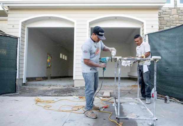 a & j home remodeling crew working on a house job site.