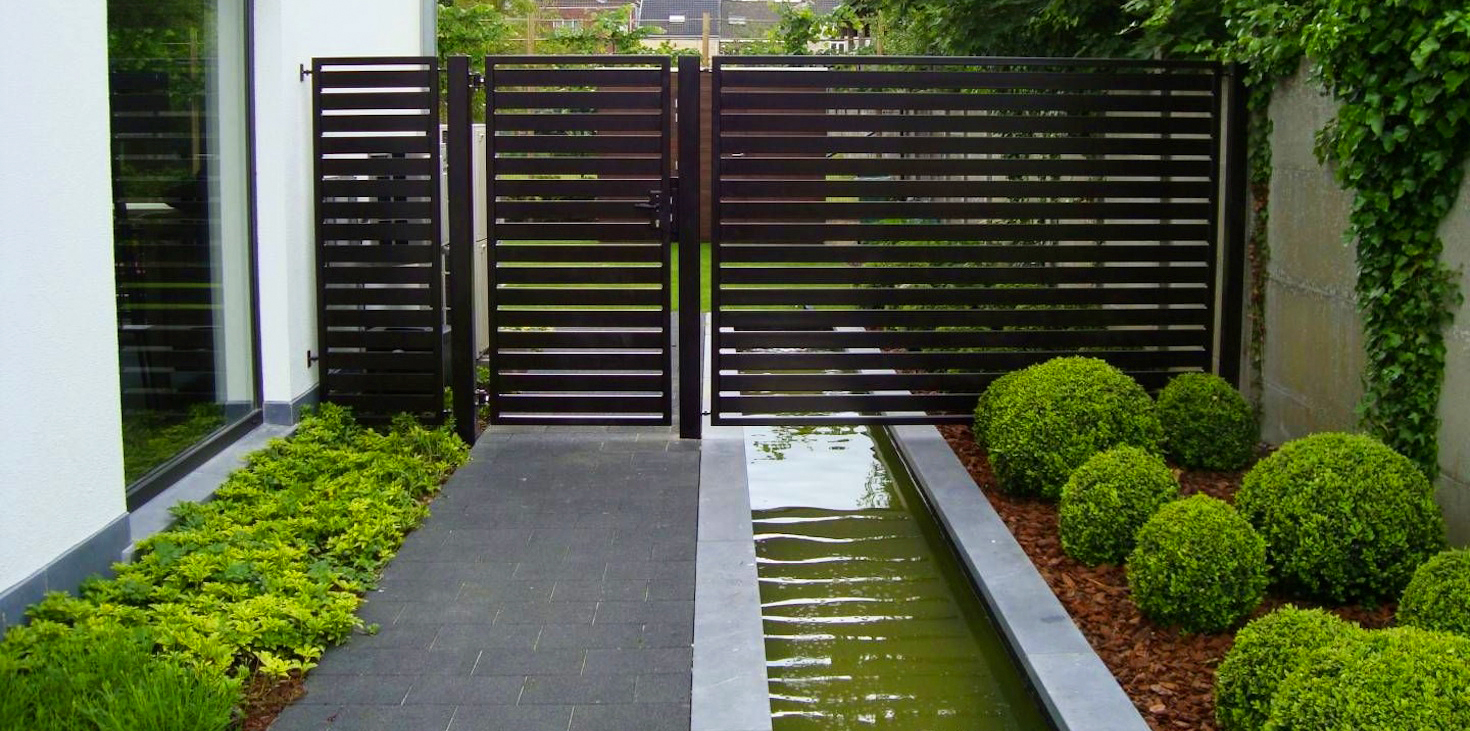 a wooden horizontal fence with a water canal running below. fence made by sterling VA fencing services